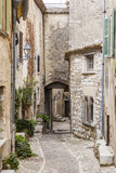 Fototapeta Uliczki - SAINT-PAUL-DE-VENCE, FRANCE, on JANUARY 9, 2017. Ancient stone buildings make architectural appearance of the typical medieval French town in the Alps