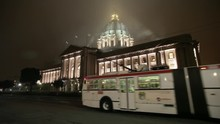 San Francisco, California - January, 2009 - Wide Angle Shot Of San Francisco City Hall With A Muni Bus Passing By On A Misty And Foggy Night.