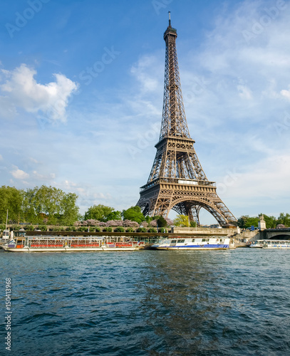 Photo Stands Paris Eiffel Tower with river on the foreground in Paris