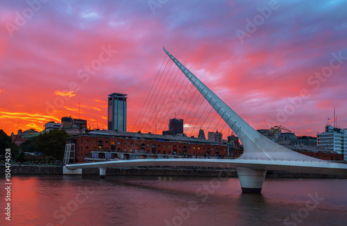 Tuinposter Buenos Aires The district of Puerto Madero and theWomen's bridge in the sunset. Buenos Aires, Argentina.