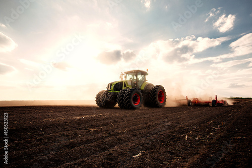 Vászonkép  Tractor on a field