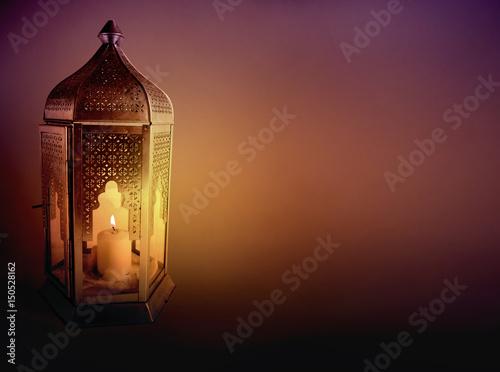 Fotografia Ornamental Arabic lantern with burning candle glowing at night