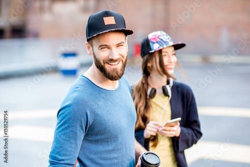 Fotografia  Portrait of a stylish man and woman outdoors
