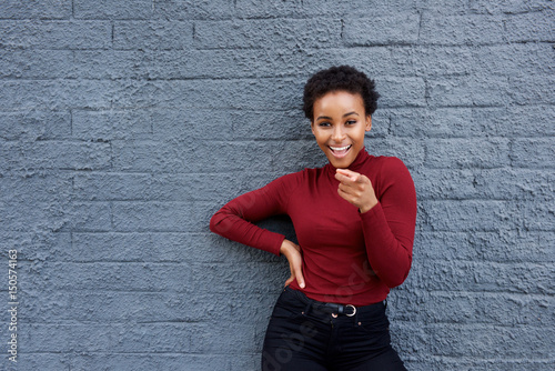 Fotografie, Obraz  happy young black woman pointing finger