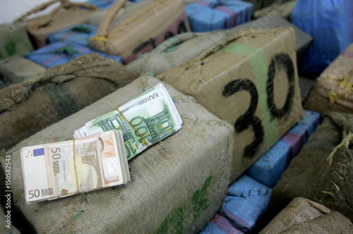 Money and packages containing more than 7000 kilograms of