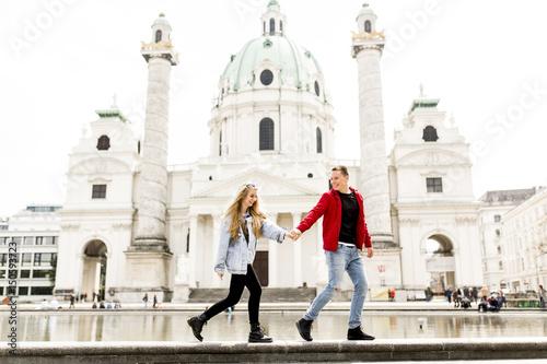 fototapeta na lodówkę Young couple walking holding hands around Vienna