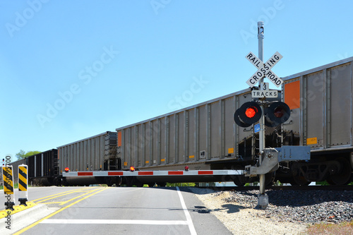 Photo Freight train at crossing gate