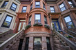 colorful brownstone buildings in a big city