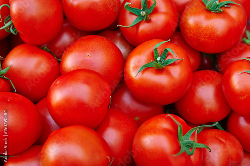 .* Description/Title/Caption: .A pile of tomatoes. Summer tray market agriculture farm full of organic tomatoes.   (selective focus).