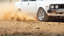 Retro Rally Car Turning In Dirt Track