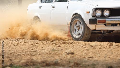 Poster Motorise Retro Rally Car turning in dirt track