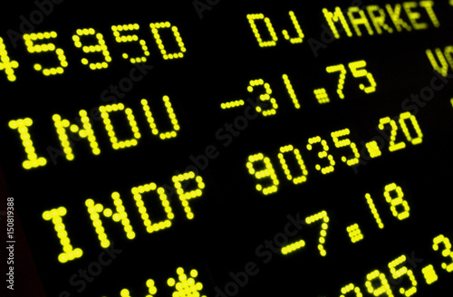 A Board At The New York Stock Exchange Displays The Dow Jones