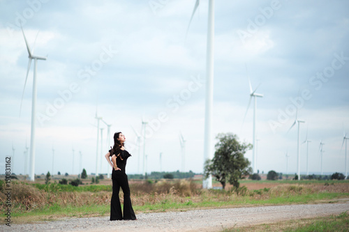 Fotobehang Lichtblauw Black women at the turbine field