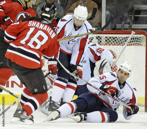 813d01d1d0b Washington Capitals Gordon and Morrisonn block shot by New Jersey Devils  Shanahan in NHL hockey game in Newark