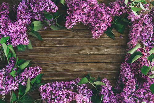 Poster de jardin Lilac The beautiful lilac on a wooden background