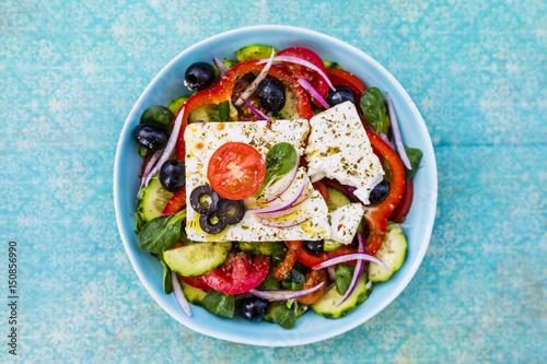 Fototapeta Choriatiki - Greek salad with feta cheese. Mediterranean food.  obraz