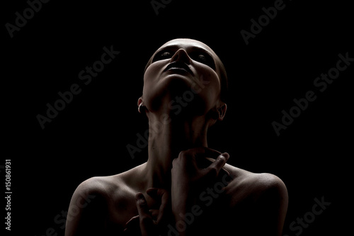Obraz Black and white shot of woman posing sensually holding head up on black background - fototapety do salonu