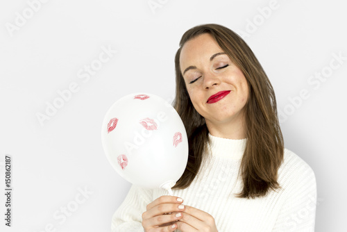Valokuva  Young girl smiling holding a balloon