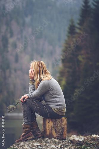 woman meditating on a lake shore Wall mural