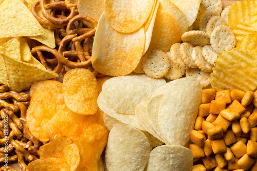 Fotografía  Salty snacks. Pretzels, chips, crackers