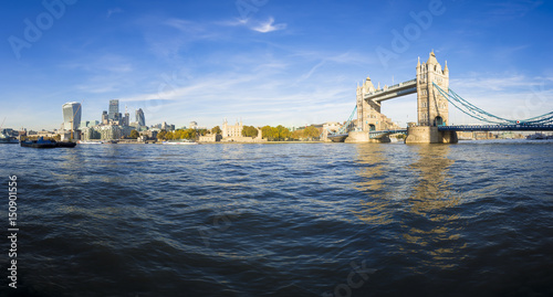 Foto op Canvas Londen Bright scenic panorama of the London city skyline with Tower Bridge from the bank of the River Thames