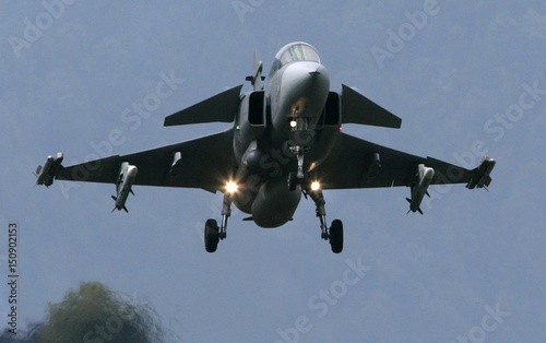 A Swedish Saab Gripen fighter plane lands at the Swiss Army Airbase