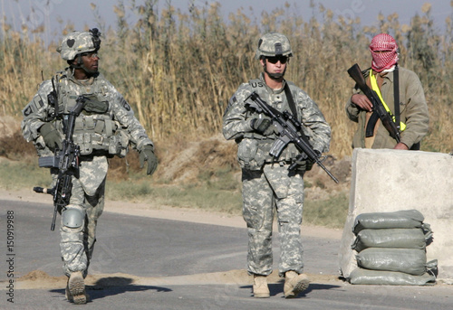 US Soldiers From 2nd Battalion 502nd Infantry Division Walk Past Member Of Armed Citizen Police