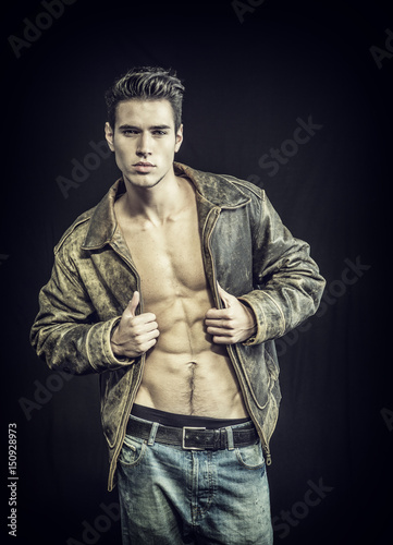 Handsome Young Man Wearing Leather Jacket On Naked Torso Isolated