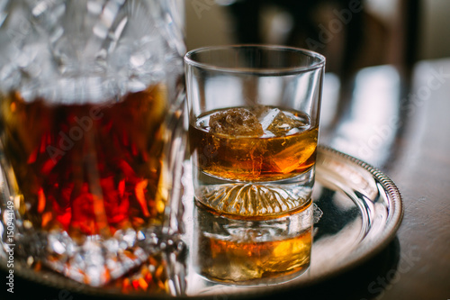 Close up of glass of whiskey on tray