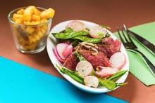 Sliced Beefsteak, Pea Legume ,radish, French Fries.