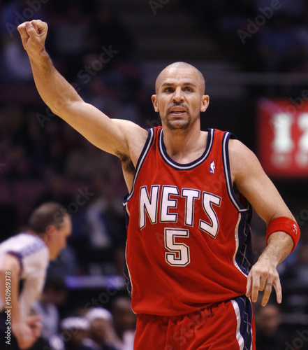 a7d3328203c New Jersey Nets guard Jason Kidd reacts after his pass found guard Vince  Carter for a ...