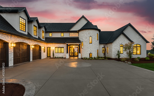 Valokuvatapetti Stunning Luxury Home Exterior at Sunset with Colorful Sky and Expansive Driveway