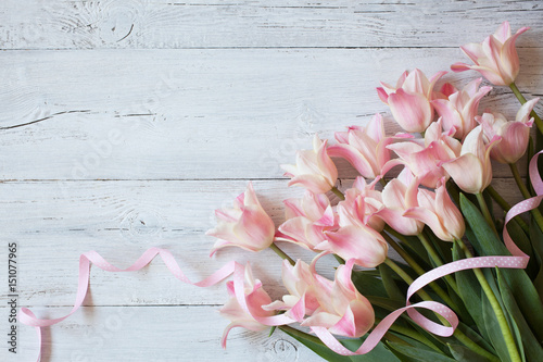 pink-tulips-on-a-wooden-backgr