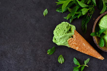 Homemade Green Ice Cream With Basil And Mint On A Black Background. Summer Dessert.
