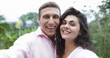 Couple Take Selfie Photo Embracing Kissing Outdoors Over Tropical Forest, Young Man And Woman Happy Smiling Lovers Slow Motion 60