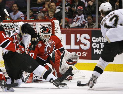 size 40 1fd08 201b5 New Jersey Devils Brodeur eyes shot by Pittsburgh Penguins ...