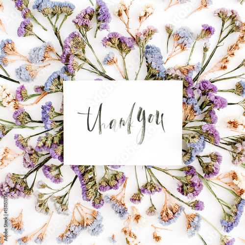 Words Thank You Written In Calligraphic Style On Paper With Blue