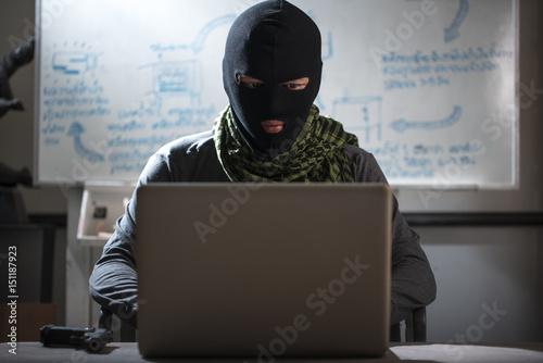 Fotografía  Terrorist working on his computer