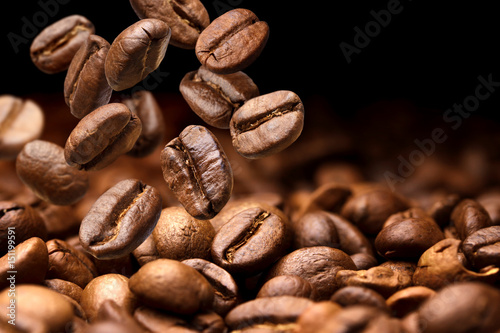 Obraz Falling coffee beans. Dark background with copy space, close-up - fototapety do salonu