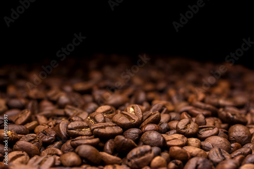 Coffee beans. Dark background with copy space, close-up