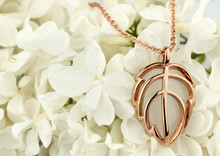 Golden Jewelry Pendant On White Flower, Copy Space