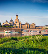 Morning view of Academy of Fine Arts and Baroque church Frauenkirche cathedral. Colorful spring scene on Elbe river in Dresden, Saxony, Germany, Europe. Artistic style post processed photo.