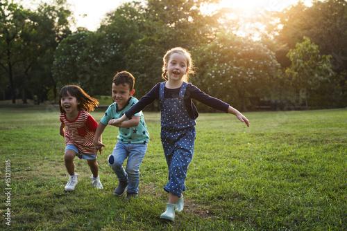 Valokuva  Children are in a field