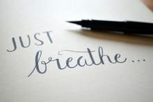 JUST BREATHE Handwritten On Notepad