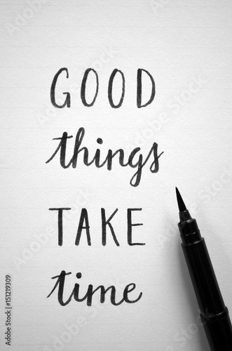 GOOD THINGS TAKE TIME written in notepad on desk with cup of coffee Wallpaper Mural