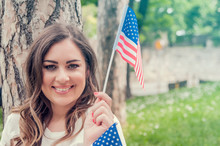 Beautiful Patriotic Young Woman With The American Flag