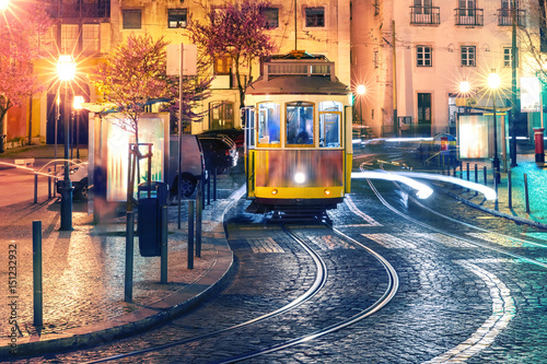 Fotografia, Obraz  Famous vintage yellow 28 tram of of Alfama, in the oldest district of the Old To