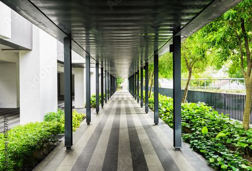 Outside walkway along a building. Modern open corridor