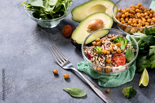 Quinoa salad with chickpeas, spinach, avocado and veggies, healthy vegan food, dieting, clean eating, vitamin and protein snack