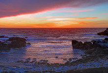 Sunset Over Rocks And Sand At Asilomar State Beach In California